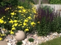 12 planting design and stone globe light